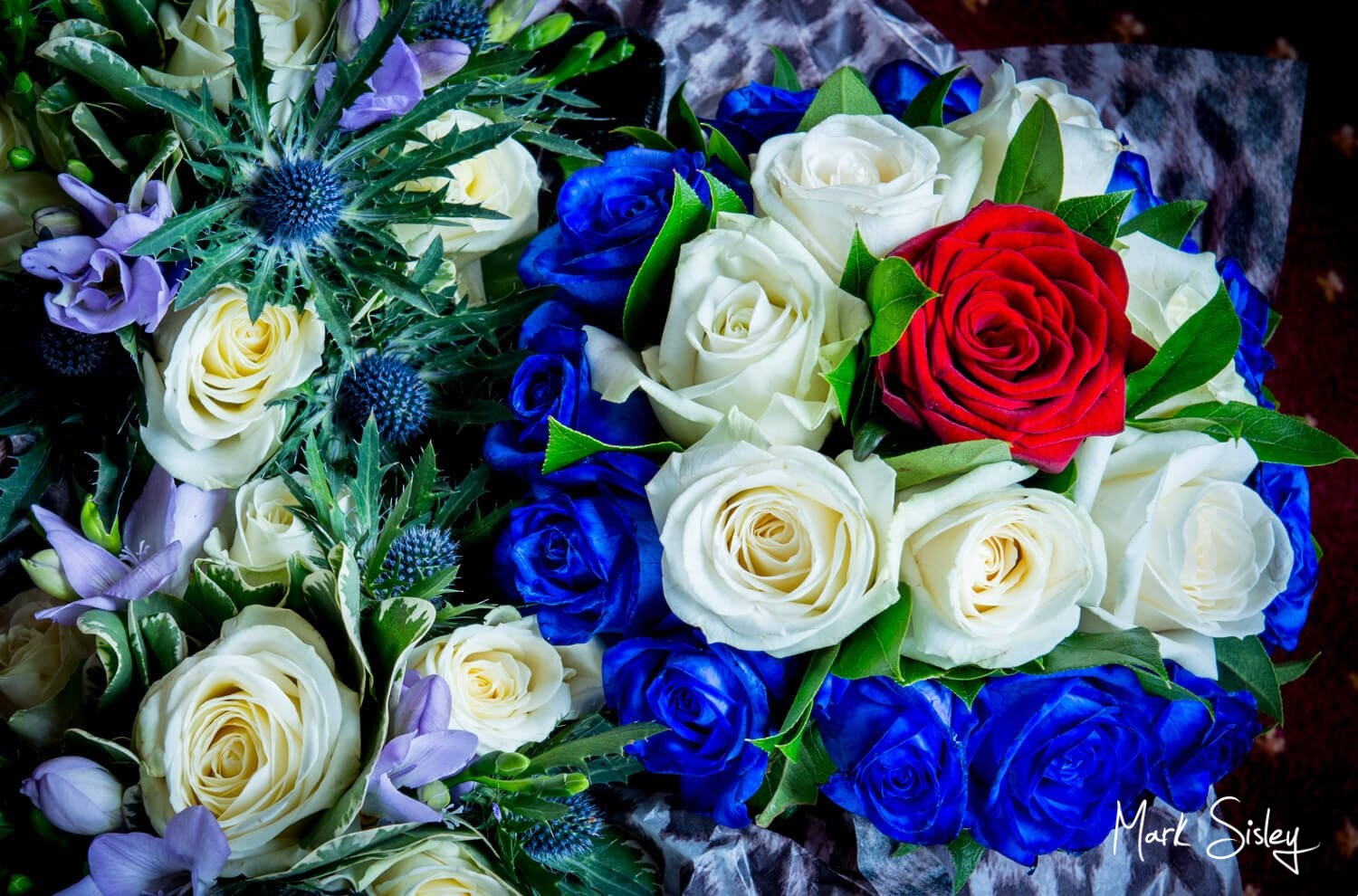 Choosing a wedding photographer - bridal bouquet of red, white and blue