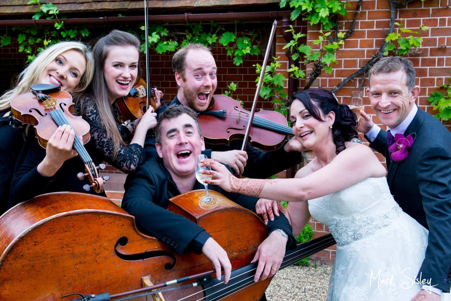 Choosing a wedding photographer - larking around with the musicians