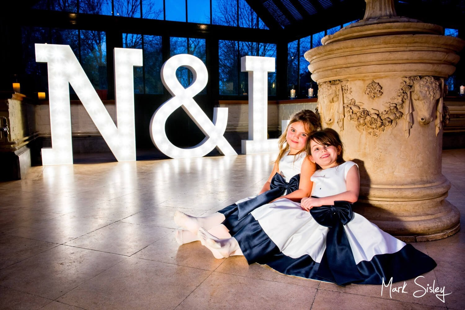 Choosing a wedding photographer - bridesmaids and giant illuminated letters