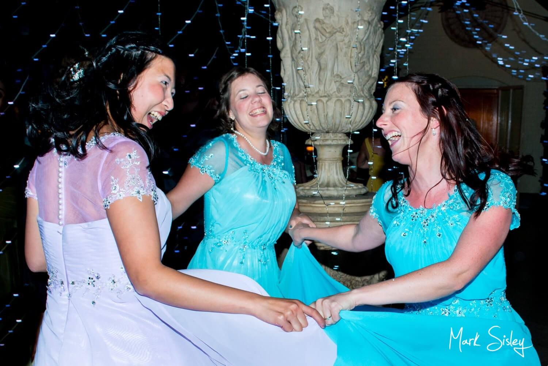 Choosing a wedding photographer - bridesmaids dancing
