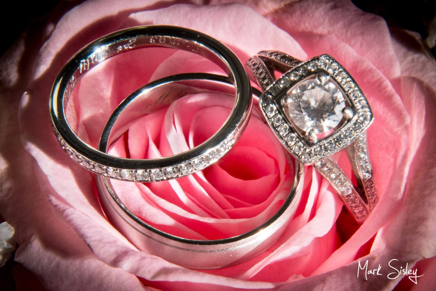 Choosing a wedding photographer - rings on rose