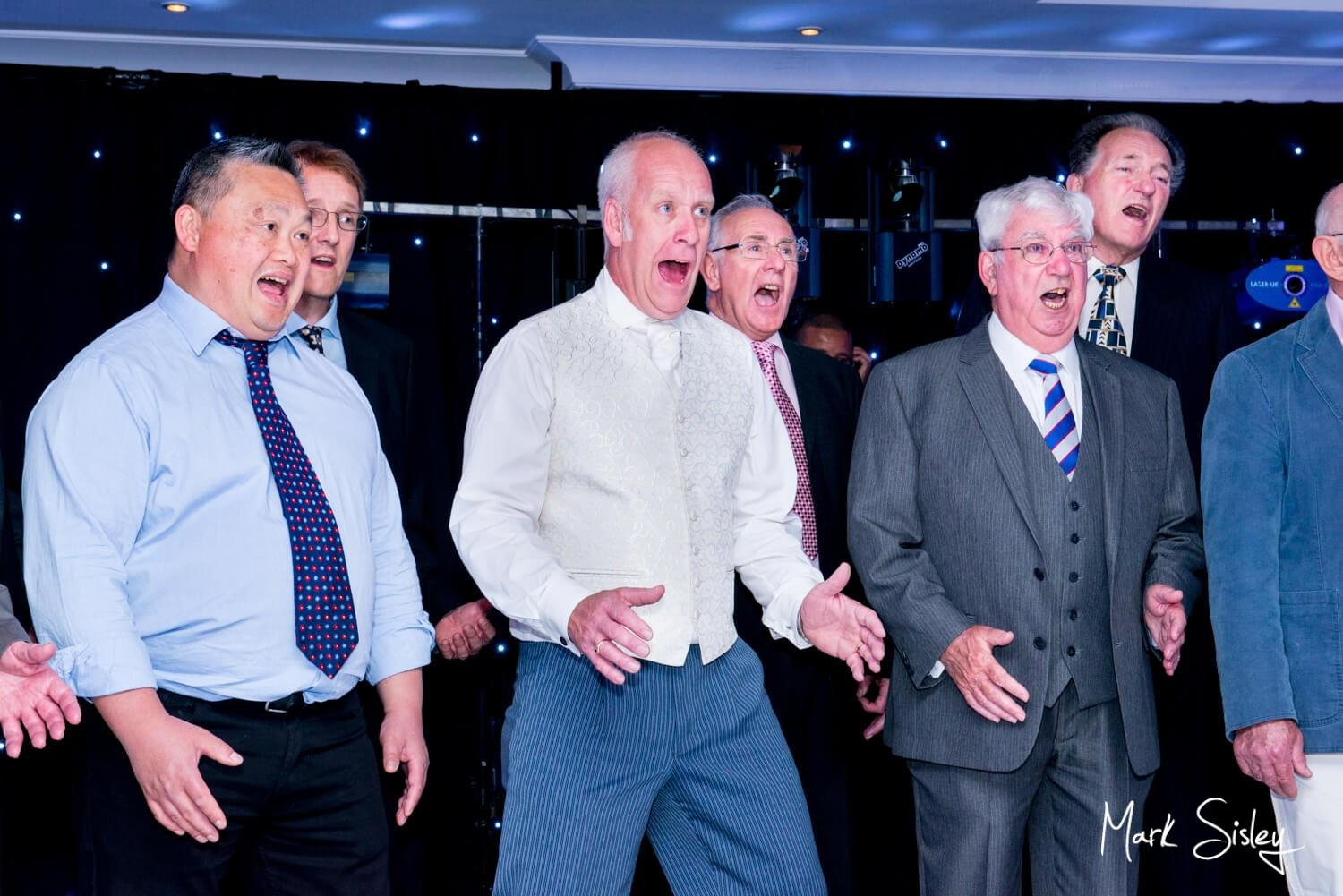 Oakley Court wedding photography of the guys singing their hearts out