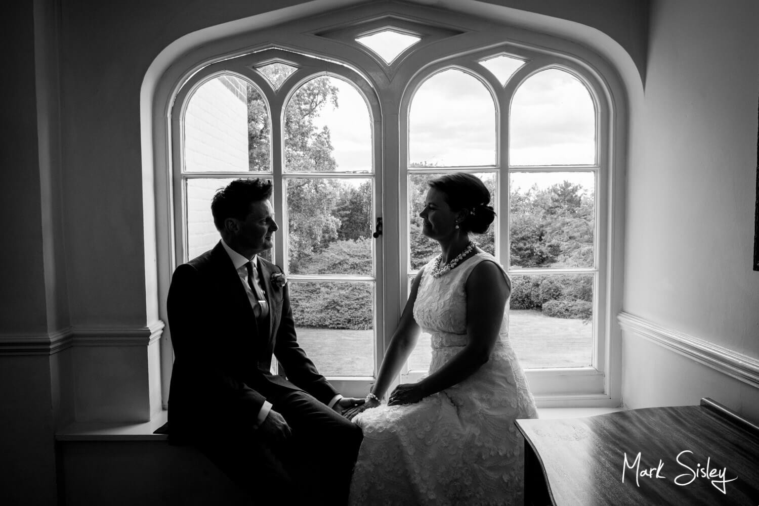 Taplow House Hotel wedding photos in an arched window