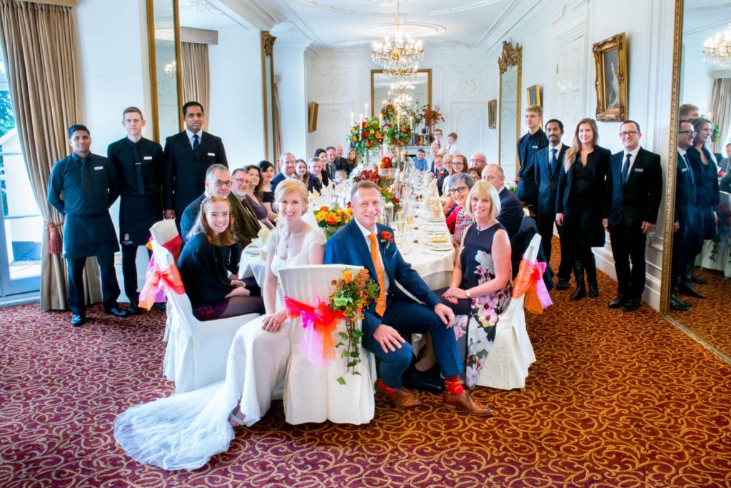 Large group pose at Taplow House autumn wedding