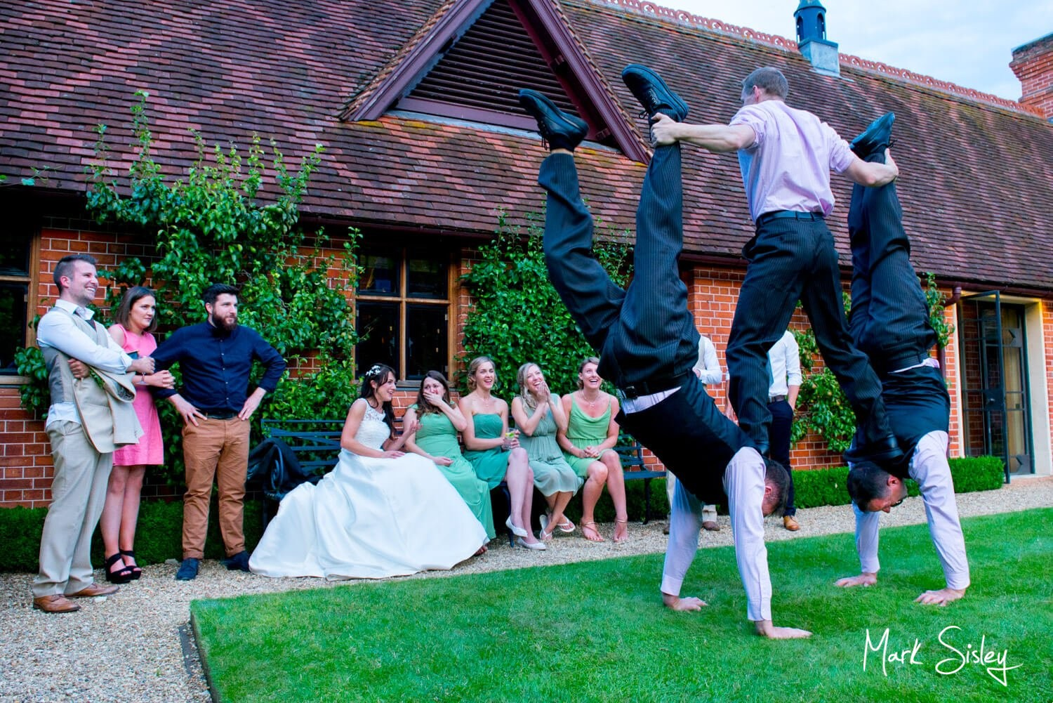 Dairy Waddedon wedding photographs - Acrobats on the lawn