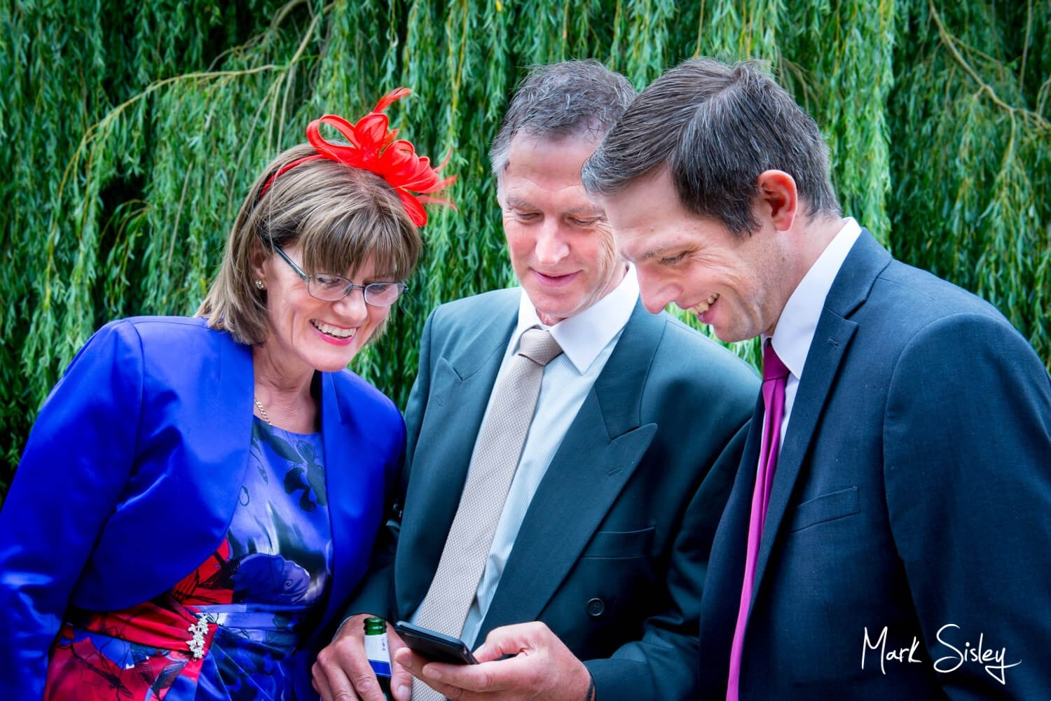The Dairy, Waddesdon wedding photography of some guests chatting