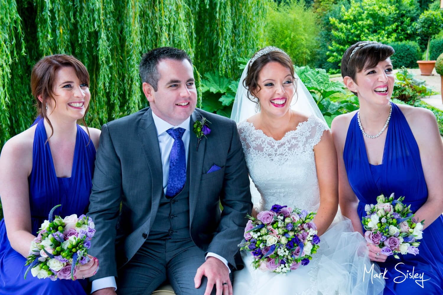 The Dairy, Waddesdon wedding group photography in the rain