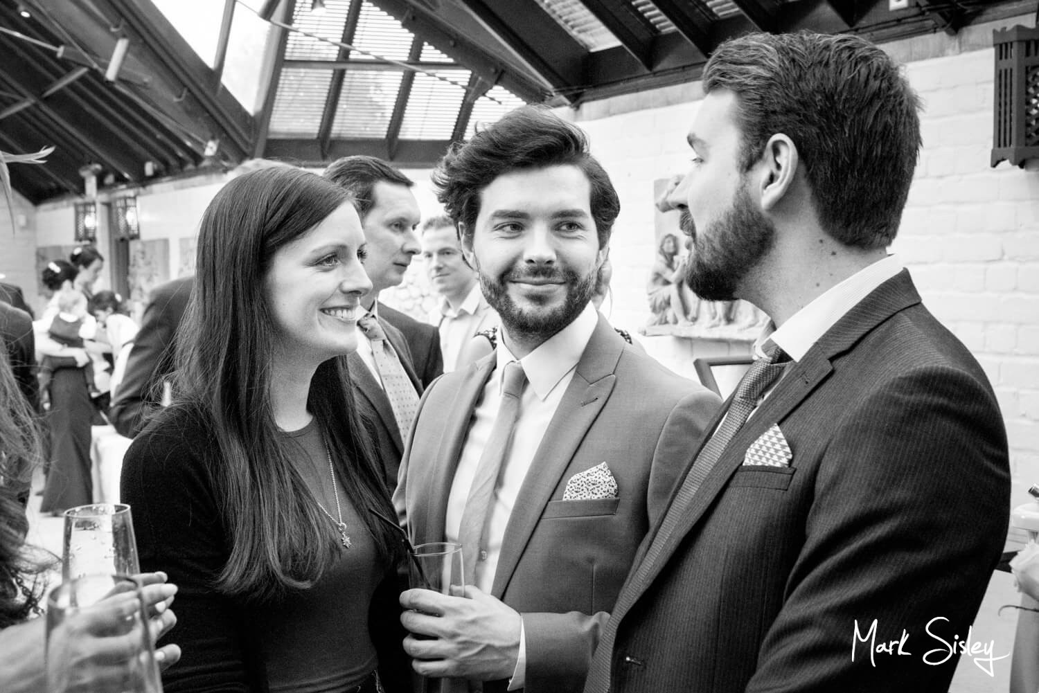 The Dairy Waddesdon Spring wedding guests enjoying the drinks reception