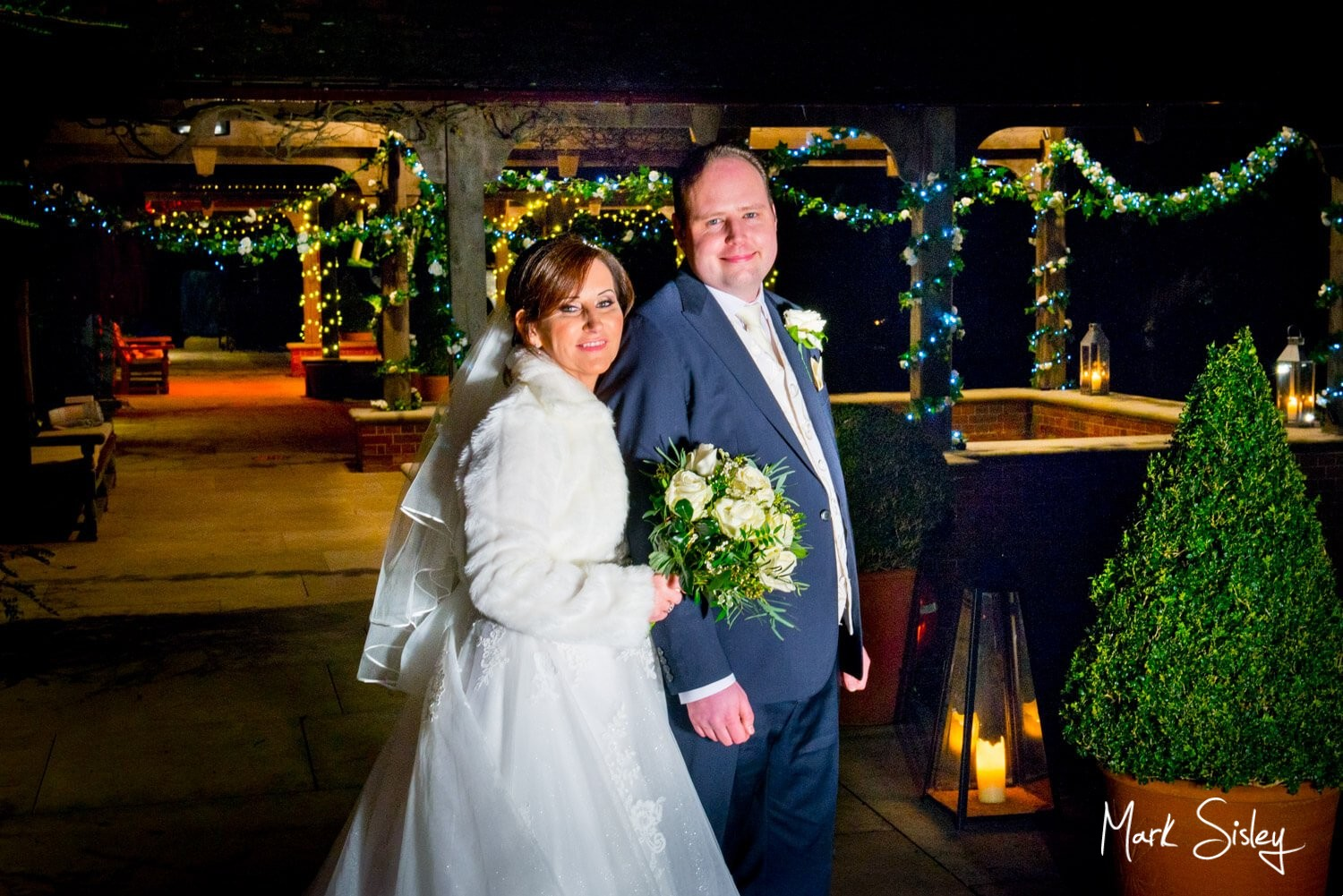 Waddesdon Dairy Christmas wedding with the pavilions lit by fairy lights