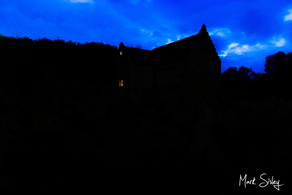 Chenies Manor House in darkness with moody blue sky