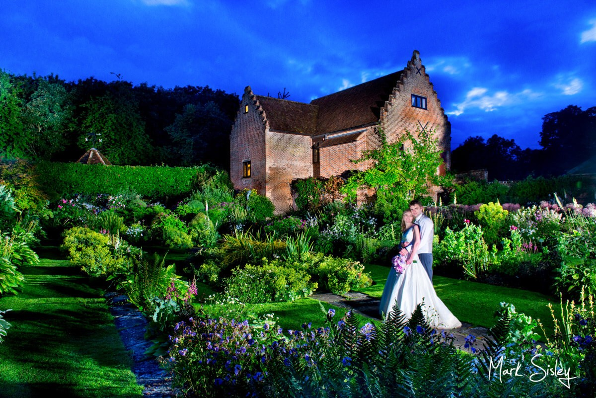Low light photography image of wedding at Chenies Manor House