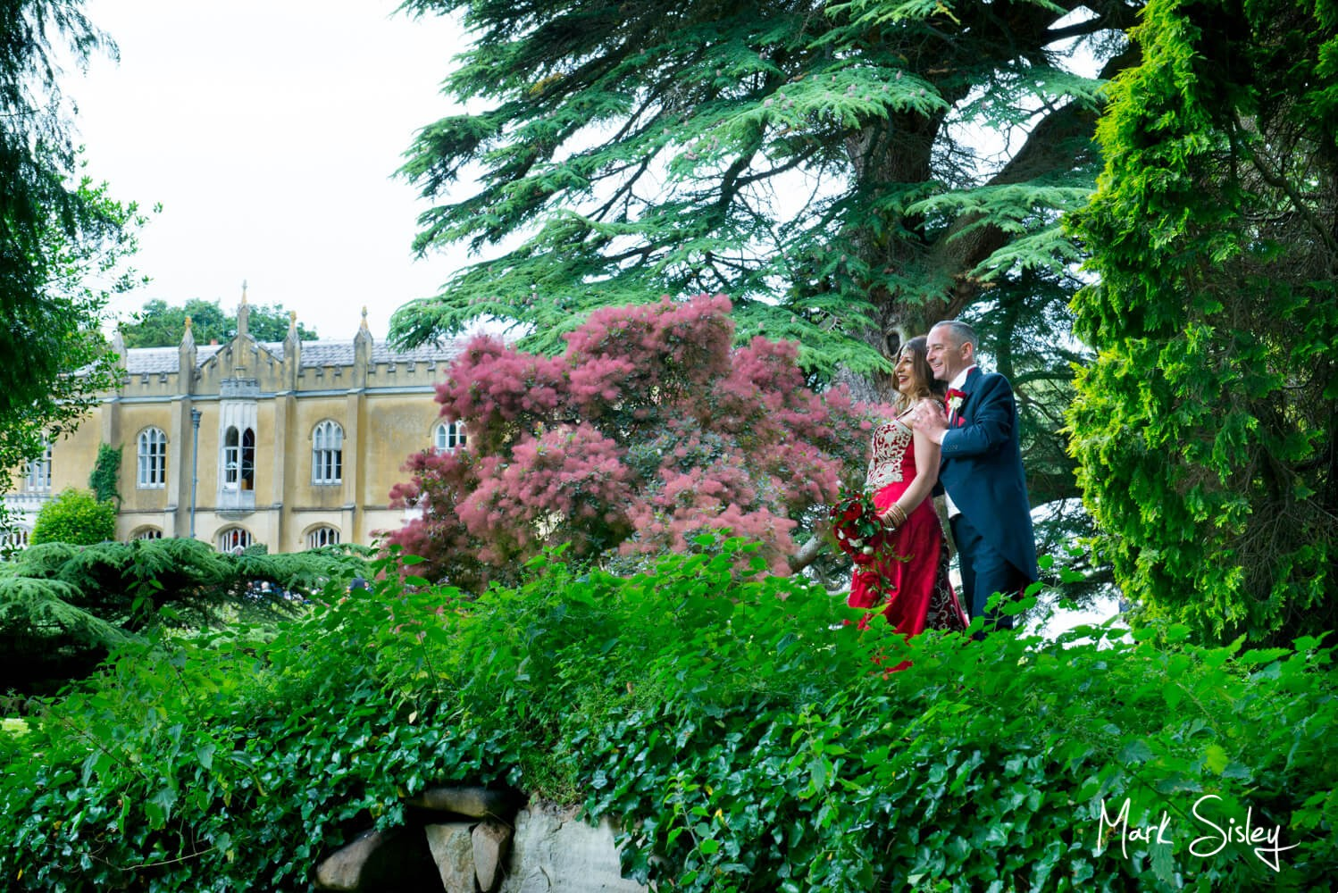Missenden Abbey wedding blog - Newlyweds on the bridge