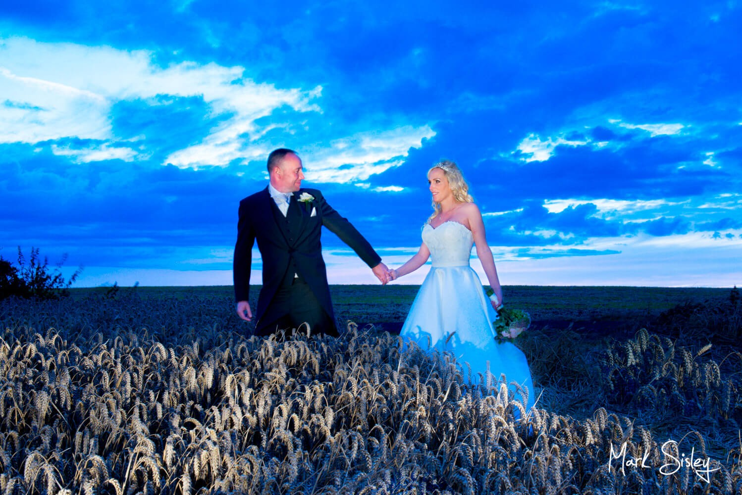 Notley Tythe Barn wedding in the wheat field at dusk