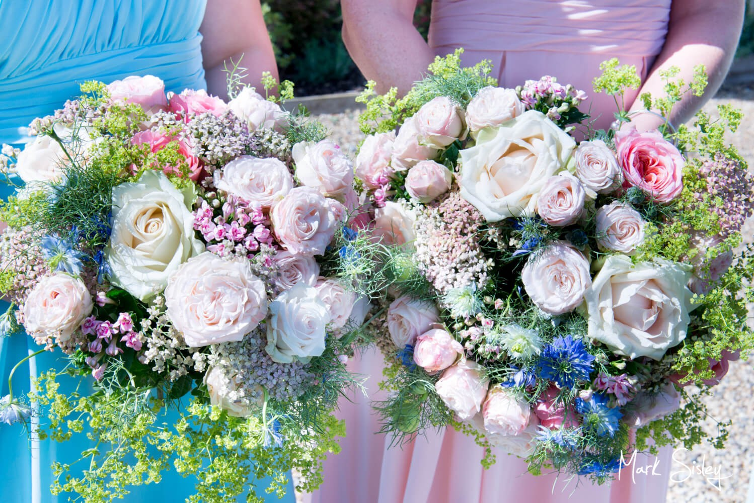 Bridesmaids flowers at Notley Tythe Barn wedding