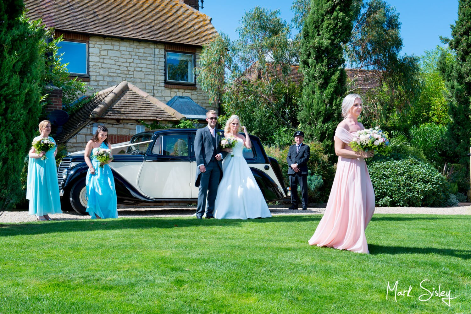 Bridesmaids arriving at ceremony at Notley Tythe Barn wedding