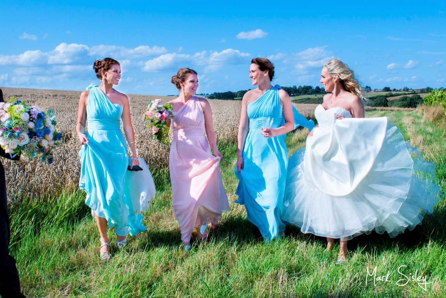 Walking in the grounds at Notley Tythe Barn wedding