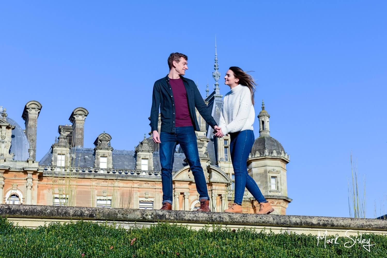 Waddesdon Manor portrait photograph of a couple walking along a wall