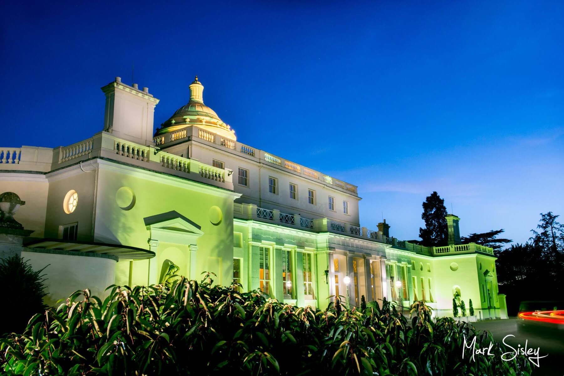 Buckinghamshire Wedding Photography - Stoke Park Hotel - twilight image with green uplighting