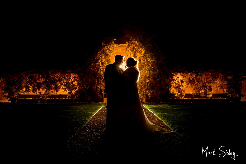 Bride & groom in silhouette at Waddesdon Dairy winter wedding