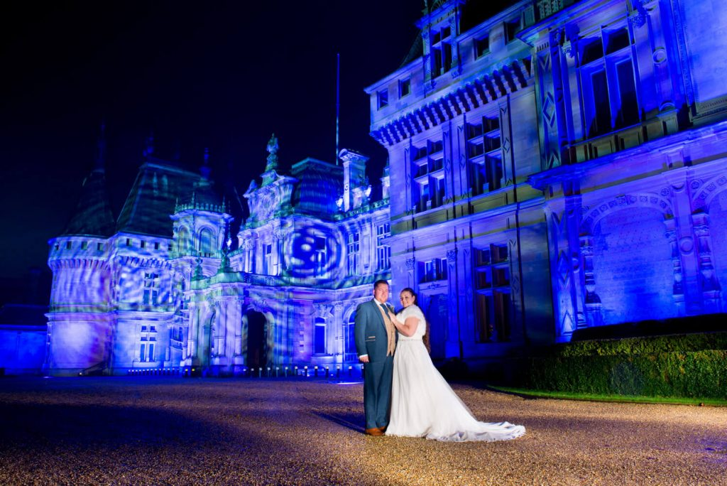 Waddesdon Dairy winter wedding photograph with the Christmas illuminations at the manor