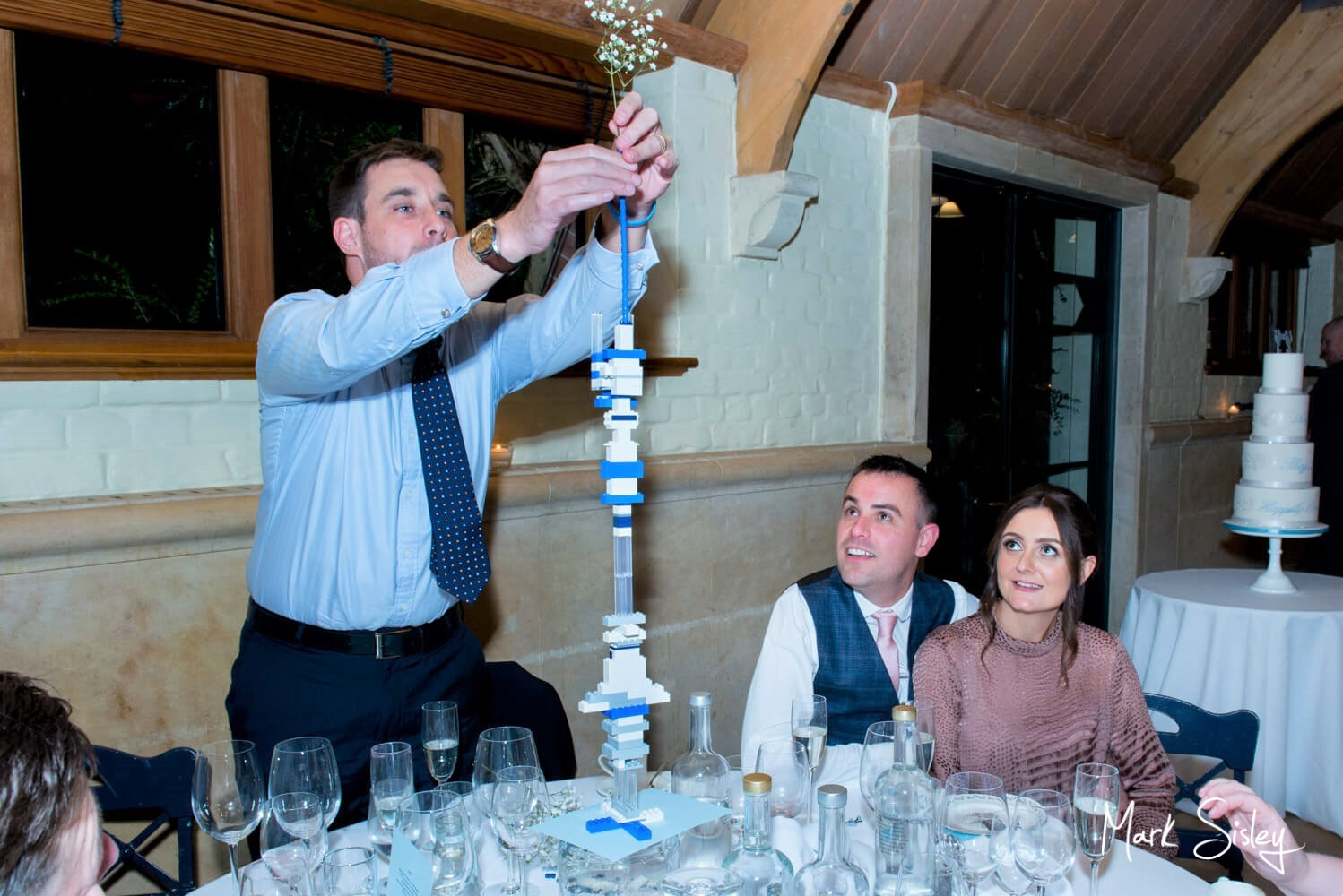 Building a Lego tower at Waddesdon Dairy winter wedding