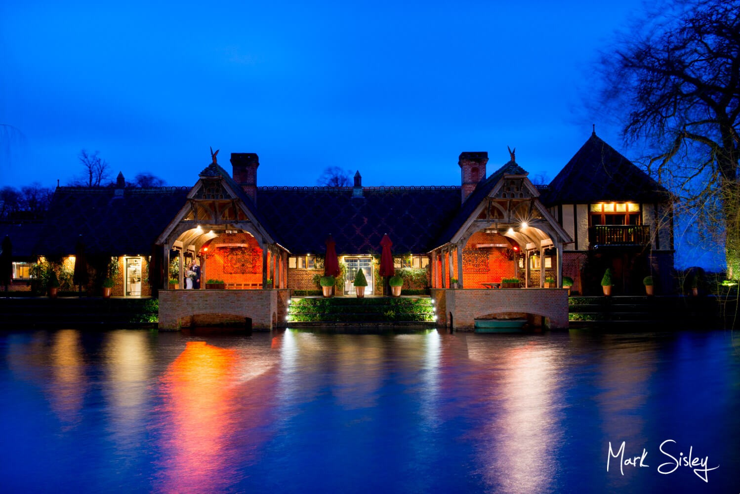 The bride & groom across the water for their Waddesdon Manor wedding during Storm Dennis