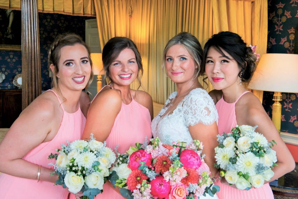 Hartwell House wedding photographs of the bride with her bridesmaids just prior to the ceremony