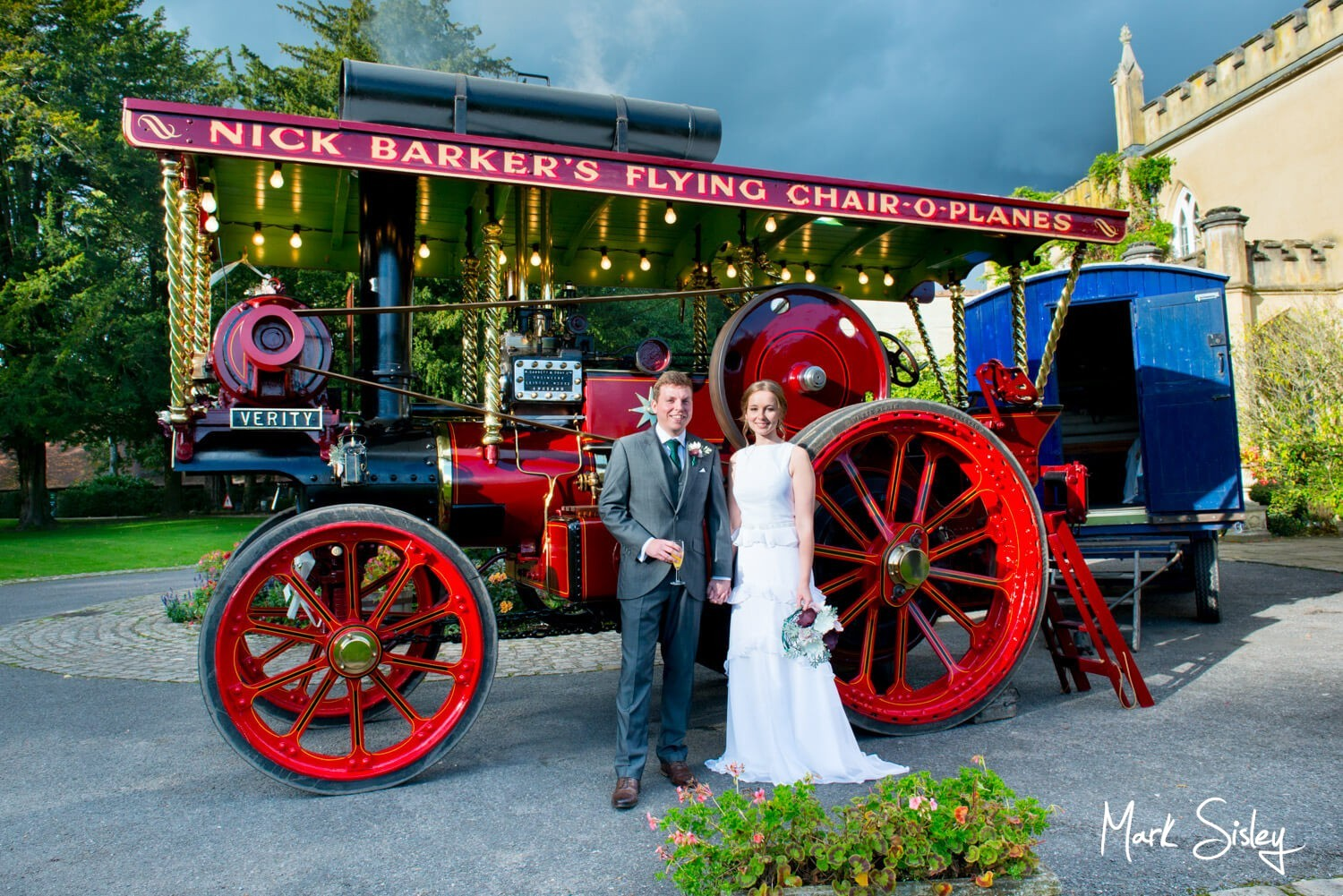 Missenden Abbey wedding pictures - bride & groom with Verity the steam engine