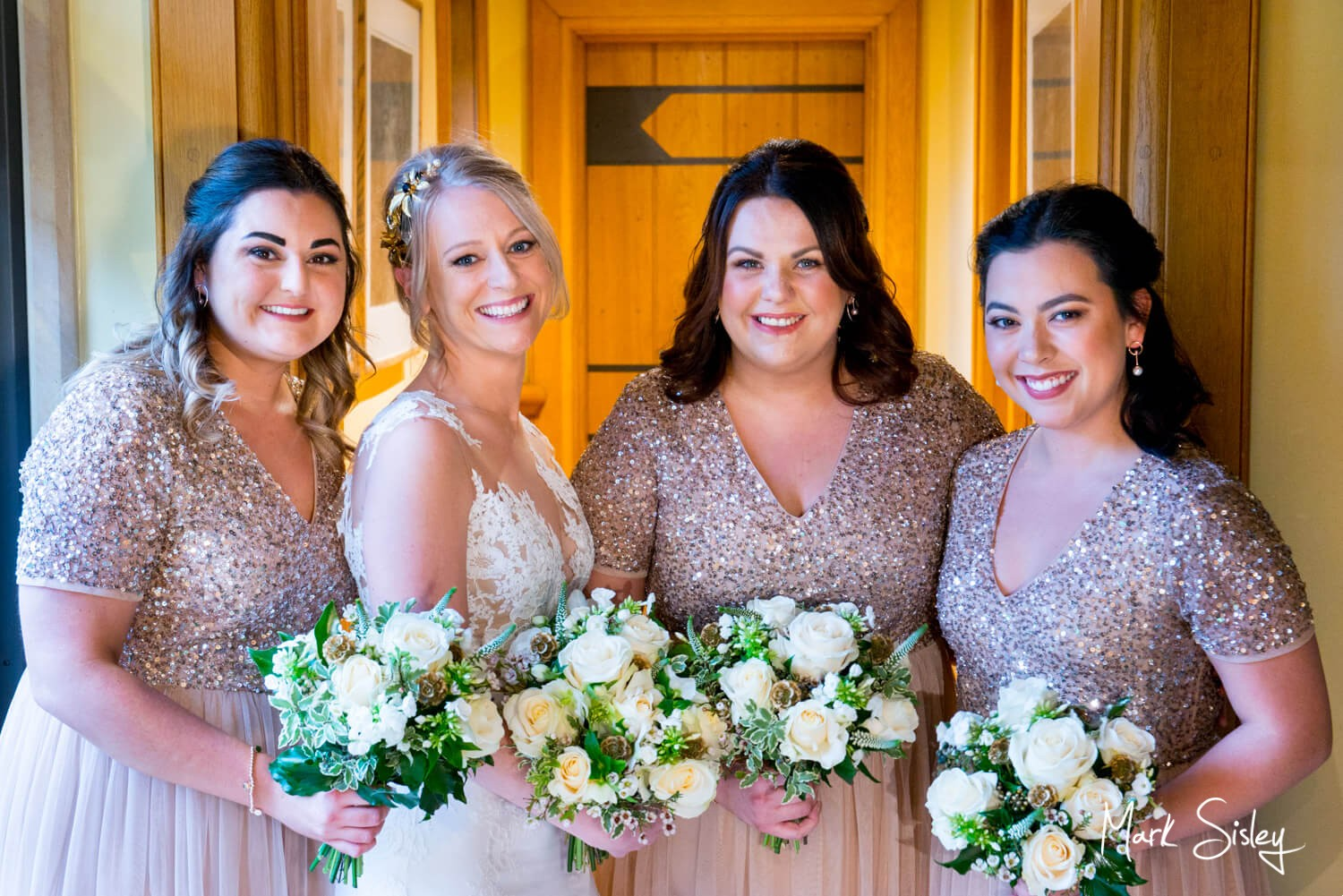 Bride & her bridesmaids at her Waddesdon Dairy winter wedding
