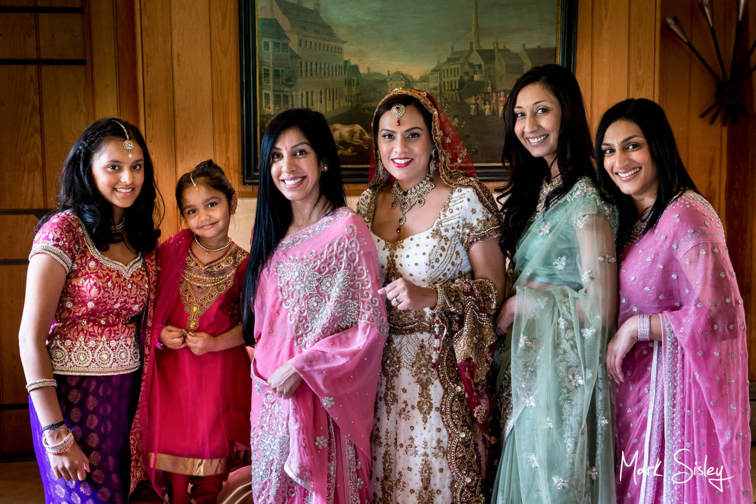 Asian wedding pictures Buckinghamshire - The bride with the ladies pre ceremony