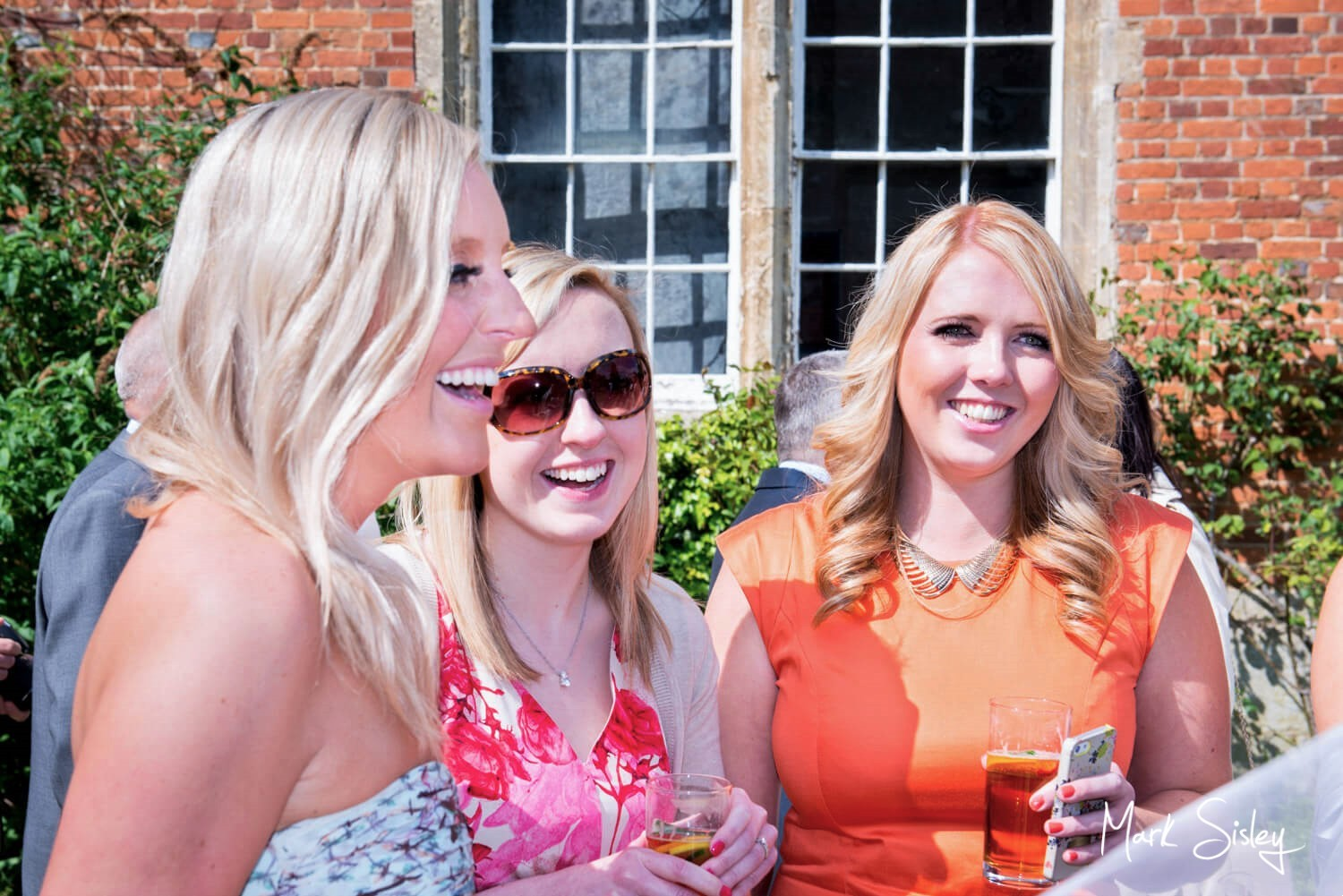 Dorton House wedding photos of some of the guests during the drinks reception
