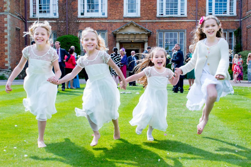 Photos at Dorton House wedding of the young girls running