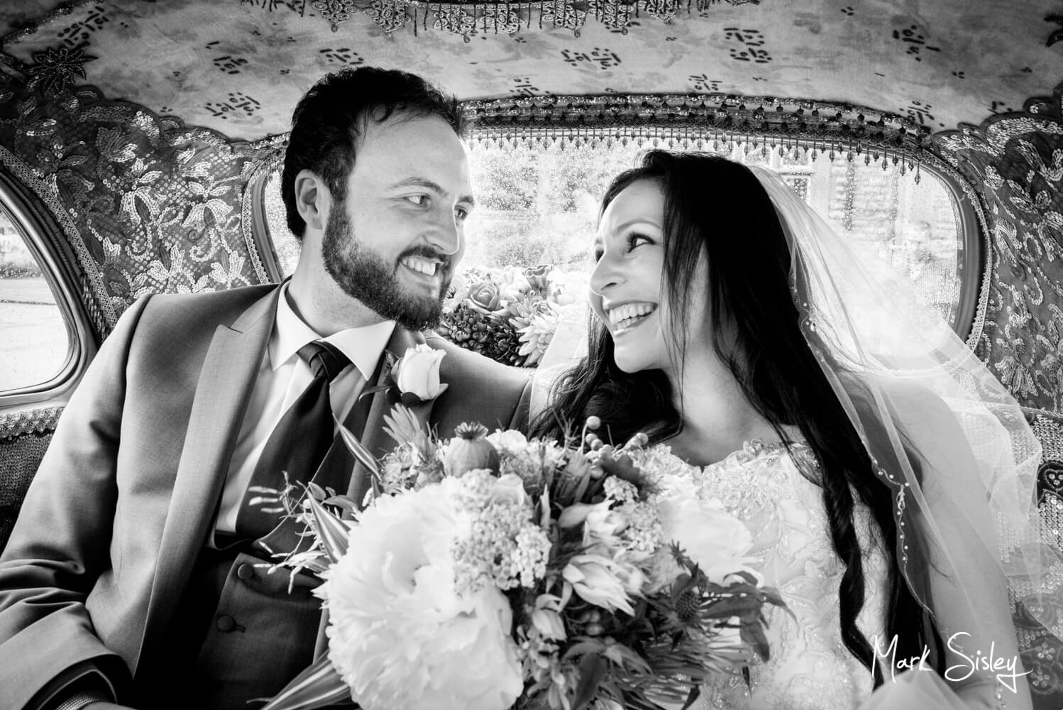Photographs of the bride on route to her Eynsham Hall wedding