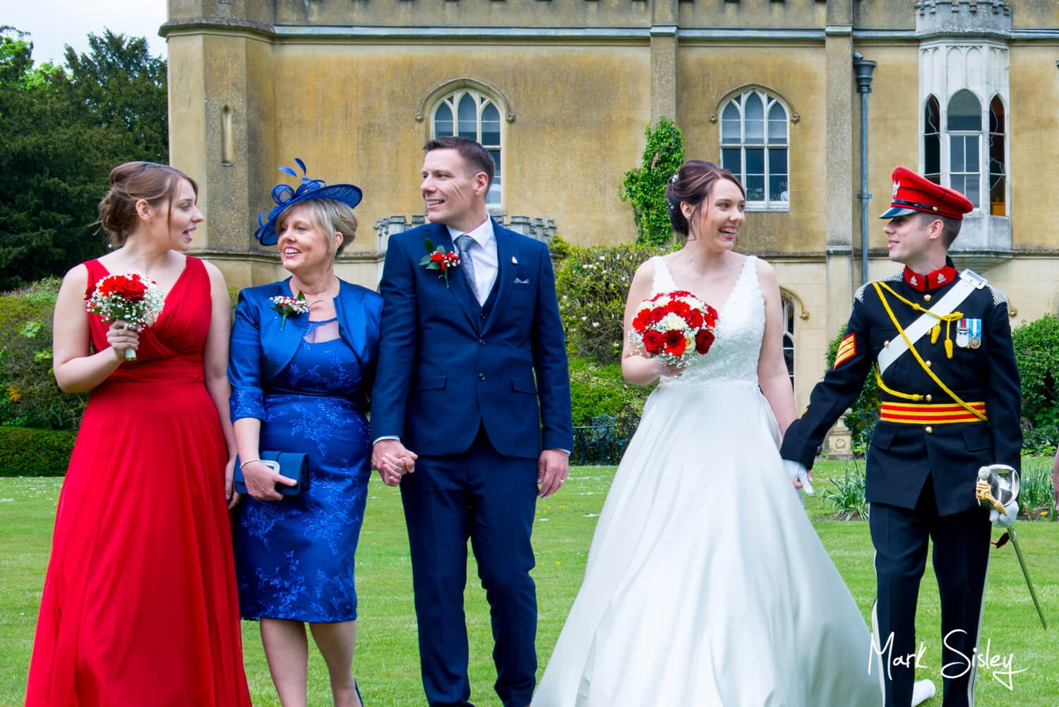 Taking a stroll on the lawns at this Missenden Abbey military wedding
