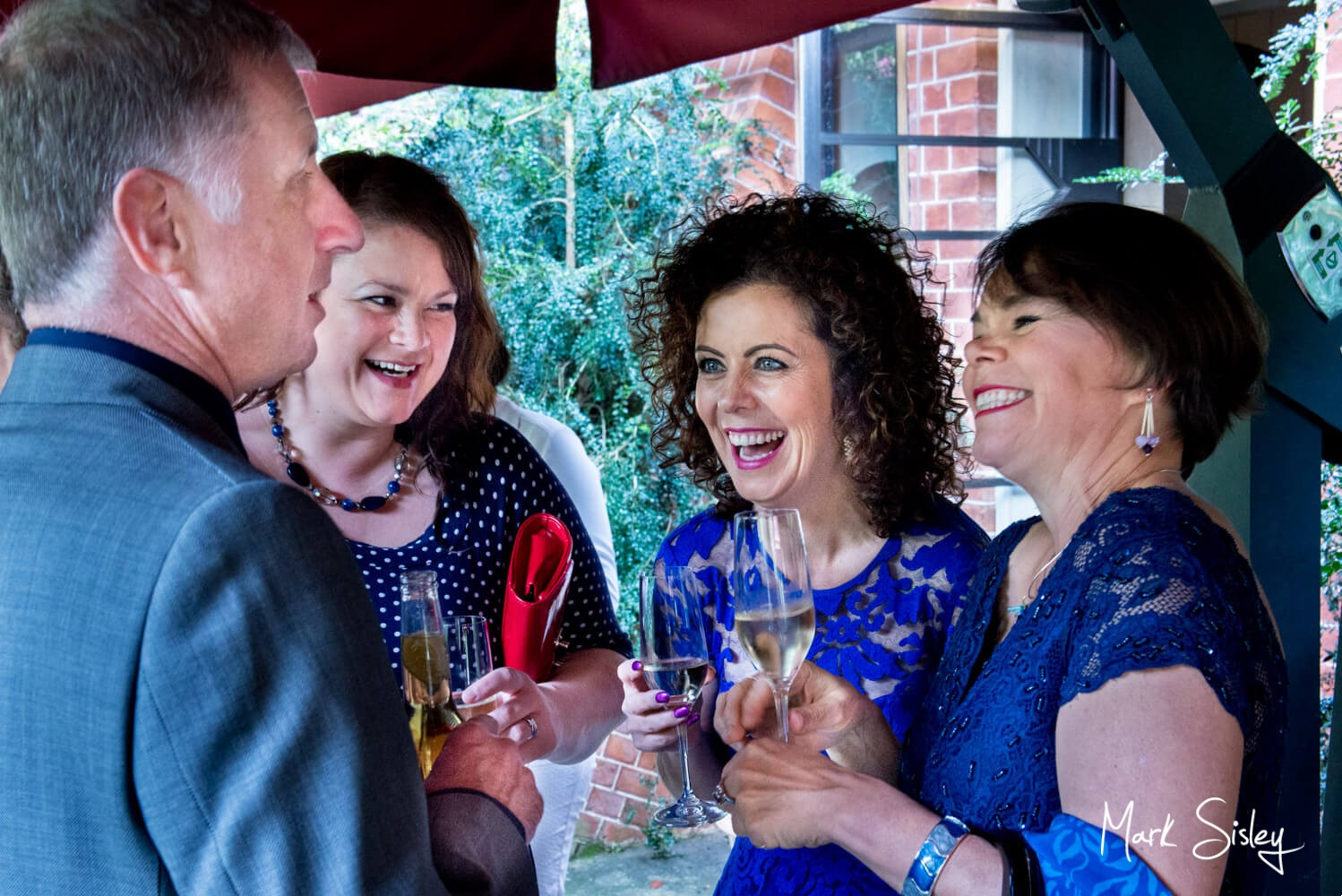 The lively drinks reception at Dairy Waddesdon Scottish themed wedding