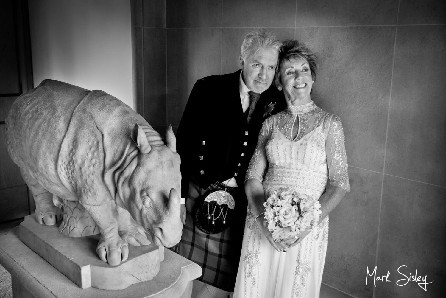 The newlyweds pose for my camera at their Dairy Waddesdon Scottish themed wedding