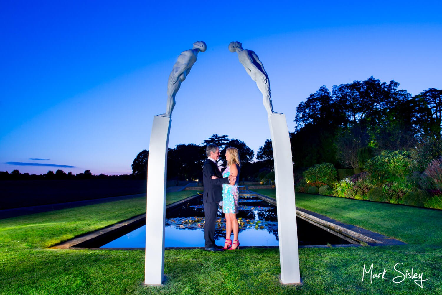Wedding photography in the gardens after dusk at The Grove Hotel in Hertfordshire