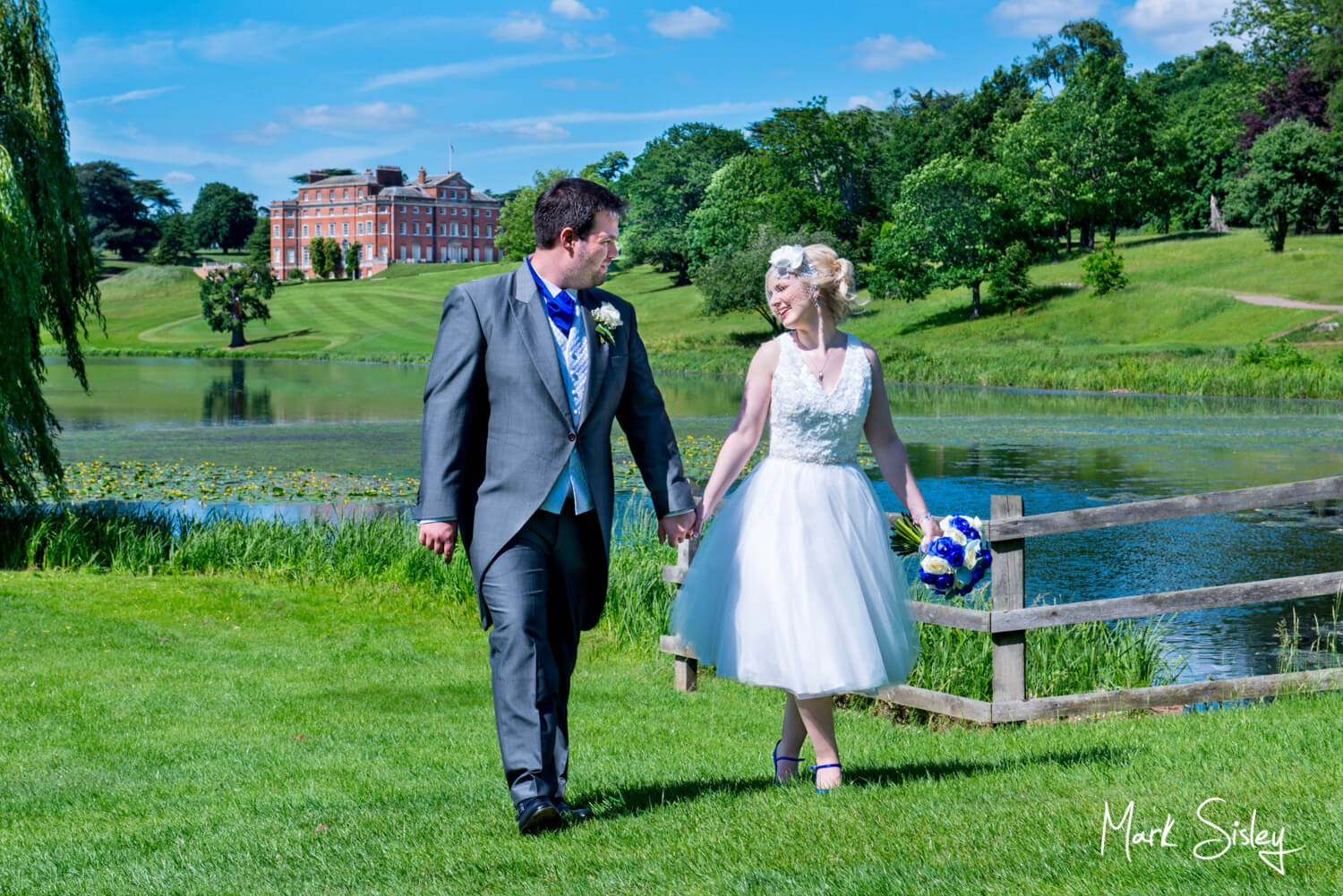 Wedding photography of the newlyweds walking in the gardens of Brocket Hall in Hertfordshire