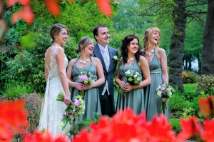 Chartridge Lodge wedding photography pose captured through the red flowers