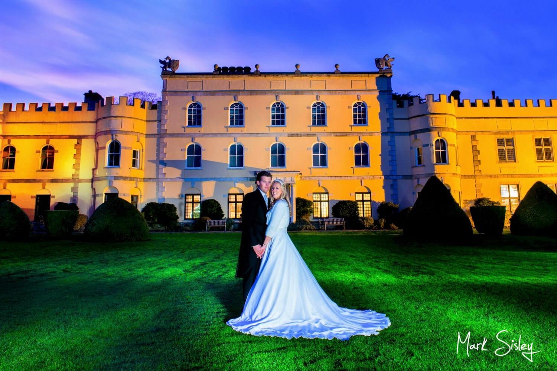 Hampden House wedding photography captured at dusk in the main gardens