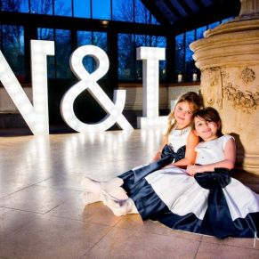 Young bridesmaids in front of giant letters - wedding at The Dairy Waddesdon Manor
