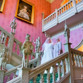 The bride on the staircase with her mother on her Hartwell House autumn wedding day