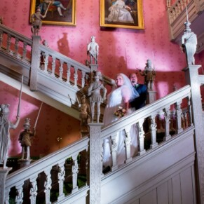 Hartwell House autumn wedding image of the newlyweds on the Jacobean staircase after dusk
