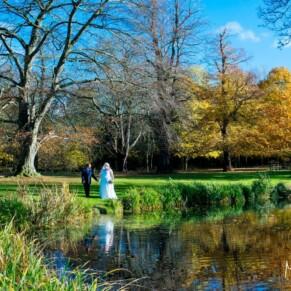 Hartwell House autumn wedding image of the newlyweds captured by the lake