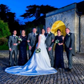 Hartwell House wedding photography of the bridal party at dusk in the Hartwell Court area