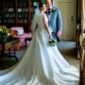 Hartwell House wedding photography of the newlyweds looking through the window