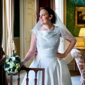Hartwell House wedding photography of the bride looking through the window