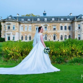 Hartwell House wedding photography of the bride with the hotel behind her
