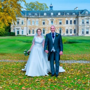 Hartwell House wedding photography of the newlyweds taking a stroll through the autumn leaves