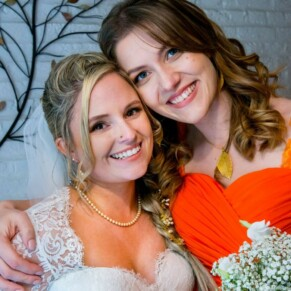 Shot of the bride with her bridesmaid at her Missenden Abbey autumn wedding